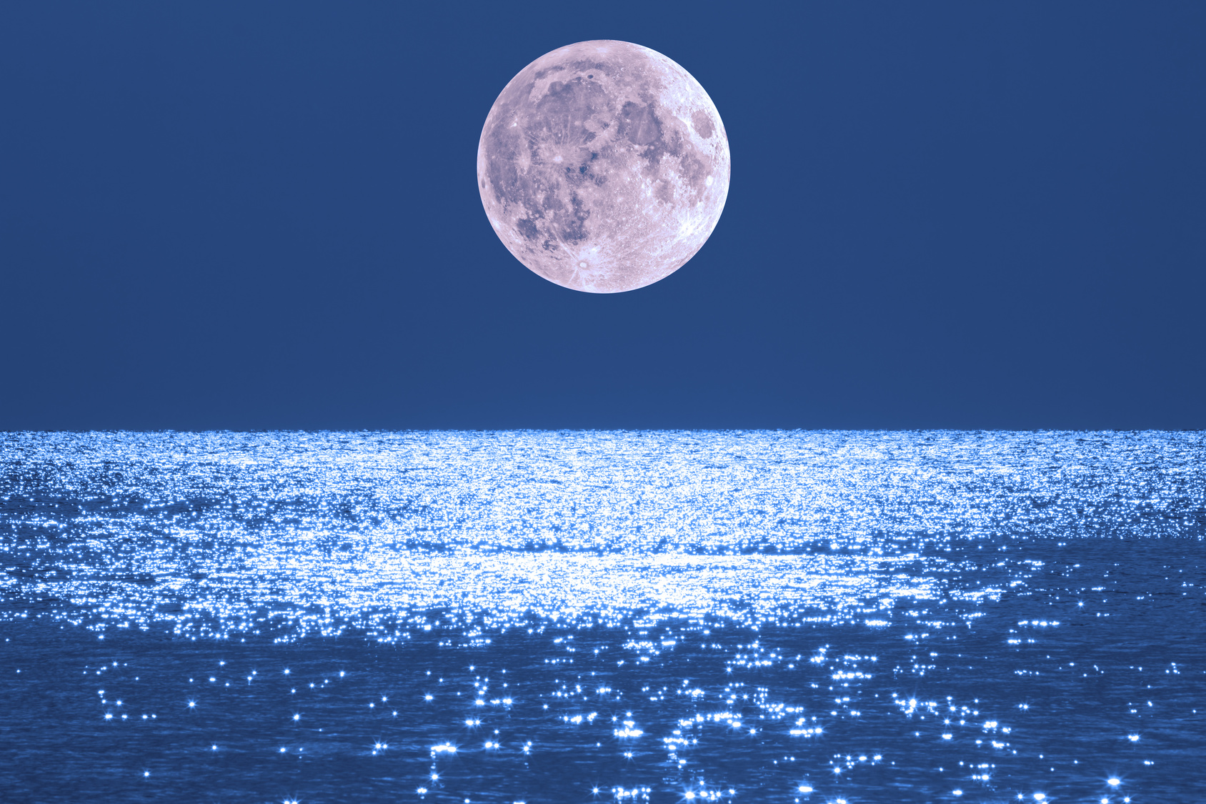 Moonrise over ocean/sea horizon. My work. No elements of NASA or other third party. Moon is my work.