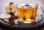 Apple Cider Drink,Juice,Cider with Spices ,Cinnamon sticks and fresh Apples.Hot drink for Autumn and Winter Christmas evenings.selective focus.