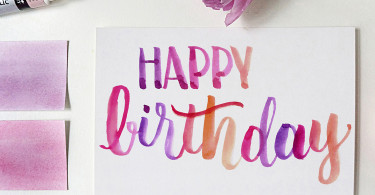 crd00029a7bar01-calligraphy-hand-lettered-happy-birthday-greeting-card-barcelona-watercolor-brush-lettering-purple-pink-orange-1500x1500