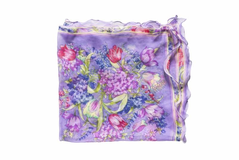 Purple silk kerchief folded on white background