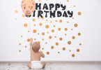 Cute baby boy at birthday party